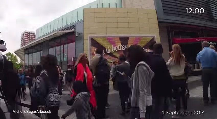 people stood around Mr Kipling